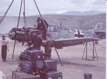 ground_crew_work_on_the_engine_of_a_bf_109e_at_the_svretv_vr